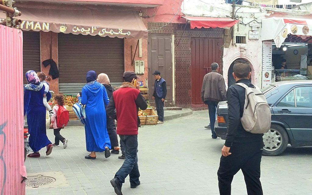 Moroccans heading to work and school in Old Medina of Casablanca.