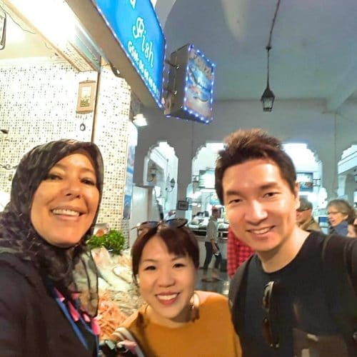 A tour guide and tourists take a selfie Inside the Central Market in Casablanca.