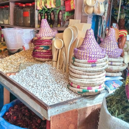 A mix of dried beans, spices, medicinal herbs and wove baskets for sale in a Casablanca market.