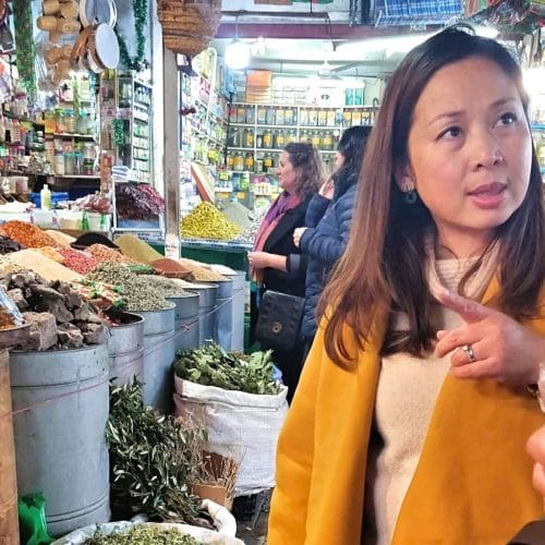 A Vietnamese woman stands in a Casablanca market during a food tour.
